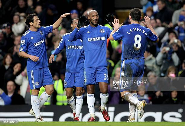 Frank Lampard of Chelsea is congraulated by teammate Nicolas Anelka after scoring his team's third goal during the Barclays Premier League match...
