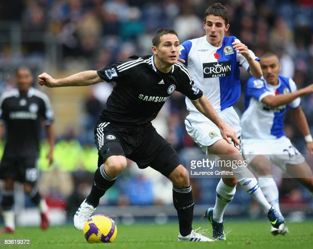 Frank Lampard of Chelsea is pressurised by Matt Derbyshire of Blackburn Rovers during the Barclays Premier League match between Blackburn Rovers and...