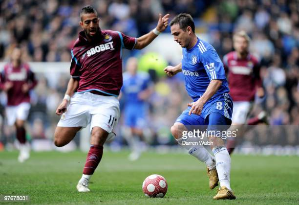 Frank Lampard of Chelsea is pursued by Mido of West Ham during the Barclays Premier League match between Chelsea and West Ham United at Stamford...