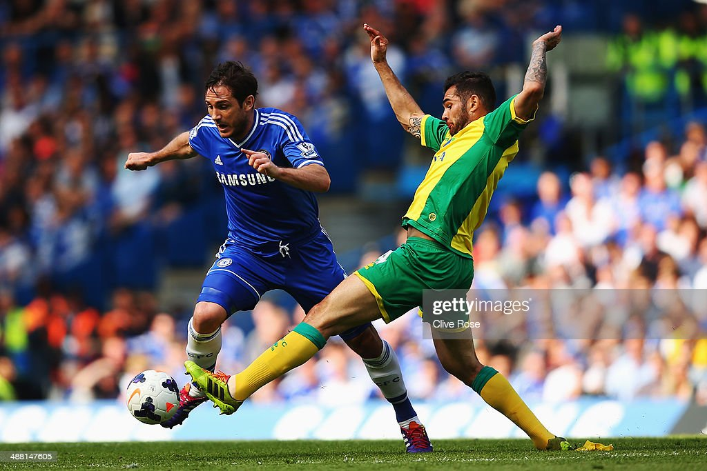 Frank Lampard of Chelsea is tackled by Bradley Johnson of Norwich City during the Barclays Premier League match between Chelsea and Norwich City at Stamford Bridge on May 4, 2014 in London, England.