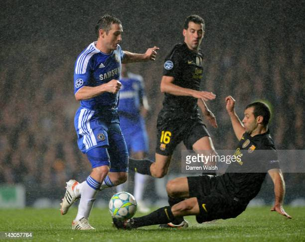 Frank Lampard of Chelsea is tackled by Javier Mascherano of Barcelona during the UEFA Champions League Semi Final first leg match between Chelsea and...