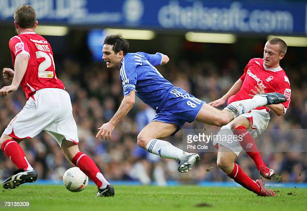 Frank Lampard of Chelsea is tripped by Sammy Clingan of Nottingham Forest during the FA Cup sponsored by EON 4th Round match between Chelsea and...