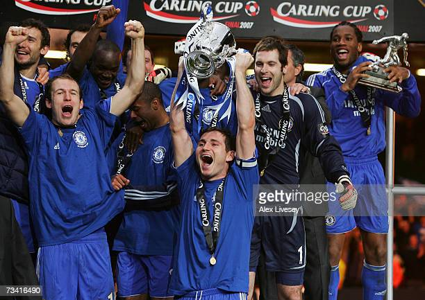 Frank Lampard of Chelsea lifts the trophy as the Chelsea players celebrate following their victory at the end of the Carling Cup Final match between...