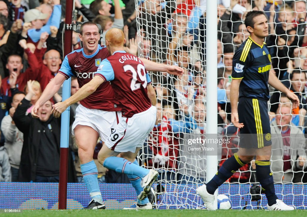 Frank Lampard of Chelsea looks despondent as Richard Dunne of Aston Villa (L) celebrates with James Collins (29) as he scores their first goal during the Barclays Premier League match between Aston Villa and Chelsea at Villa Park on October 17, 2009 in Birmingham, England.