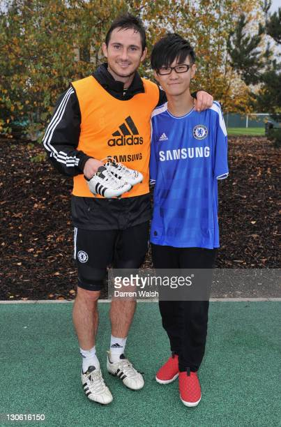Frank Lampard of Chelsea meets Liu Wei, a armless pianist who won China's Got Talent 2010 during a training ground visit on October 27, 2011 in...