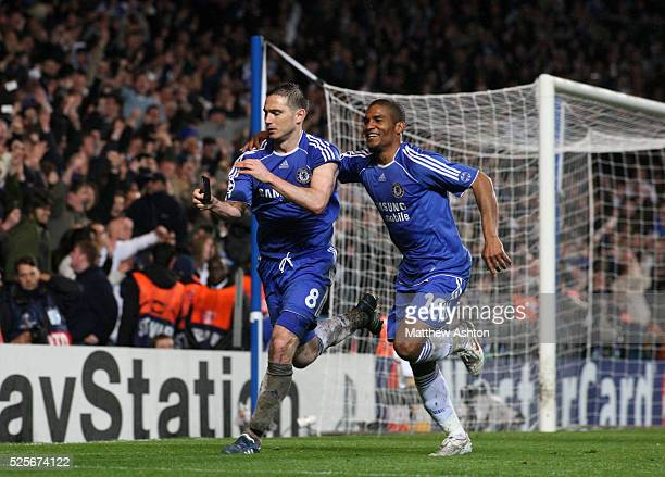 Frank Lampard of Chelsea removes a black armband in memory of his mother as he celebrates after scoring a penalty to make it 21 with Florent Malouda