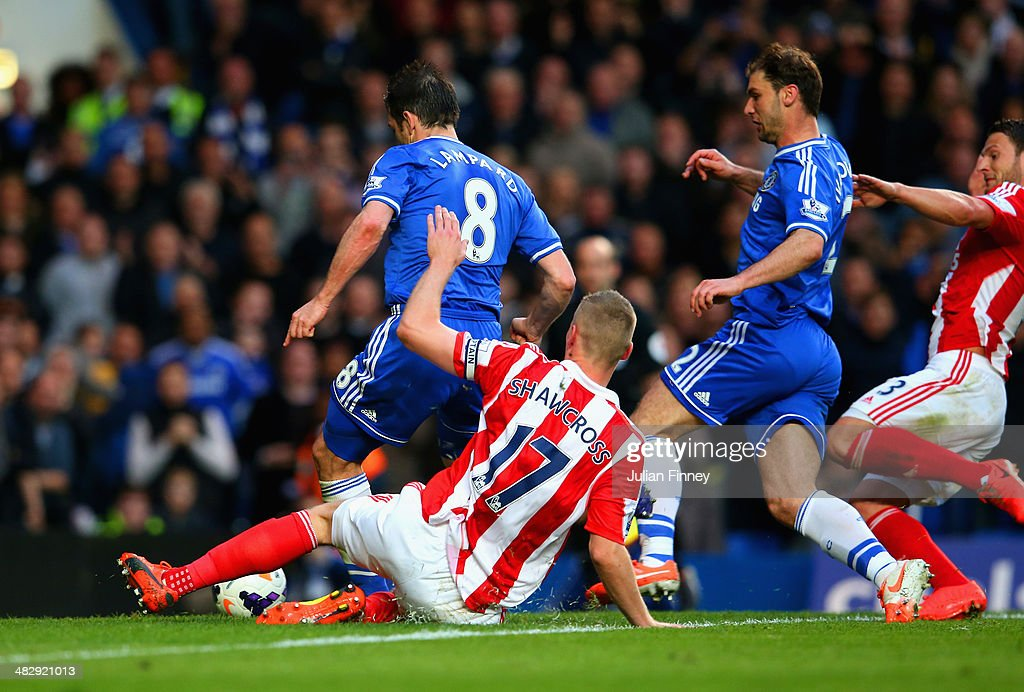 Frank Lampard of Chelsea scores off the rebound of his own penalty during the Barclays Premier League match between Chelsea and Stoke City at Stamford Bridge on April 5, 2014 in London, England.