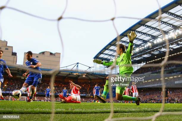 Frank Lampard of Chelsea scores off the rebound of his own penalty during the Barclays Premier League match between Chelsea and Stoke City at...