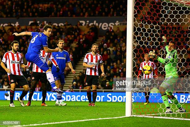 Frank Lampard of Chelsea scores their first goal past Vito Mannone of Sunderland during the Barclays Premier League match between Sunderland and...
