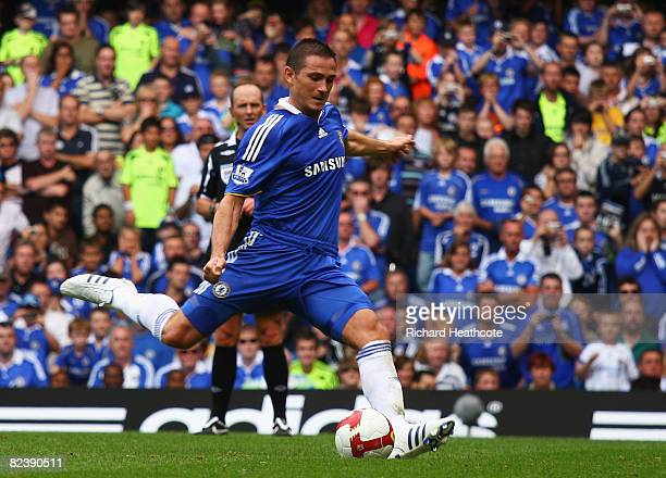 Frank Lampard of Chelsea scores their third goal from the penalty spot during the Barclays Premier League match between Chelsea and Portsmouth at...