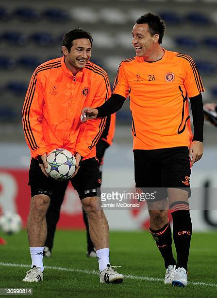 Frank Lampard of Chelsea shares a joke with team mate John Terry during a training session prior to the Champions League Group E match between KRC...