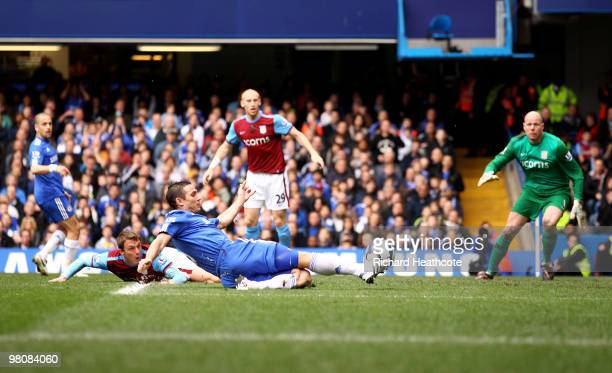 Frank Lampard of Chelsea shoots to score the opening goal during the Barclays Premier League match between Chelsea and Aston Villa at Stamford Bridge...