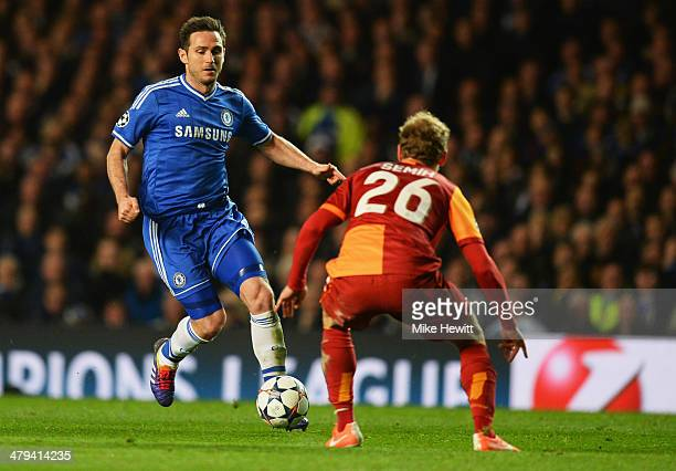 Frank Lampard of Chelsea takes on Semih Kaya of Galatasaray during the UEFA Champions League Round of 16 second leg match between Chelsea and...
