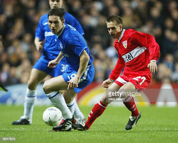 Frank Lampard of Chelsea turns away from Philipp Lahm of Stuttgard during the UEFA Champions League match between Chelsea and VfB Stuttgart at...