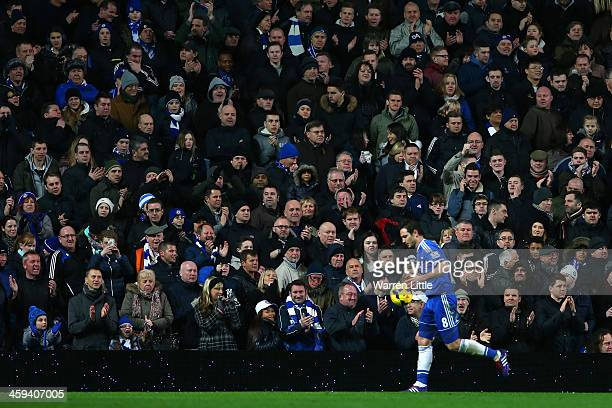 Frank Lampard of Chelsea walks past the Chelsea fans as he prepares to take a corner during the Barclays Premier League match between Chelsea and...