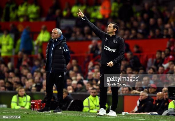 Frank Lampard of Derby County gives his team instructions as Jose Mourinho Manager of Manchester United looks on during the Carabao Cup Third Round...