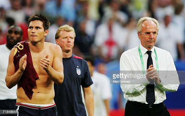 Frank Lampard of England and Manager Sven Goran Eriksson applaud the fans following defeat in the FIFA World Cup Germany 2006 Quarterfinal match...