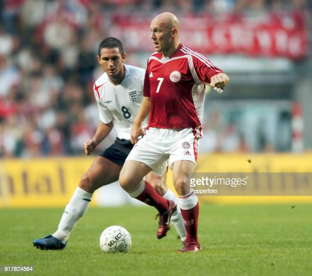 Frank Lampard of England and Thomas Gravesen of Denmark in action during the International friendly match between Denmark and England at The Parken...