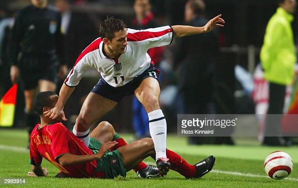 Frank Lampard of England battles with Costinha of Portugal during the International Friendly match between Portugal and England at the Faro-Loule...