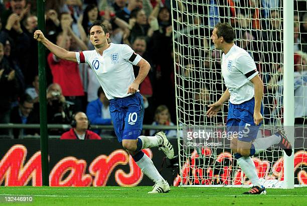 Frank Lampard of England celebrates with Phil Jagielka as scores their first goal during the international friendly match between England and Spain...