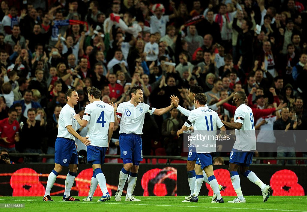 Frank Lampard of England (10) celebrates with team mates as scores their first goal during the international friendly match between England and Spain at Wembley Stadium on November 12, 2011 in London, England.