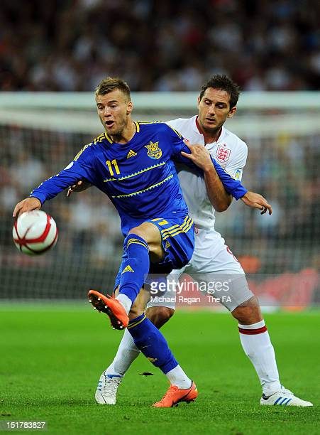 Frank Lampard of England holds up Andrii Iarmolenko of Ukraine during the FIFA 2014 World Cup qualifier group H match between England and Ukraine at...