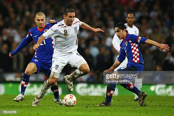Frank Lampard of England is challenged by Mladen Petric of Croatia during the Euro 2008 Group E qualifying match between England and Croatia at...