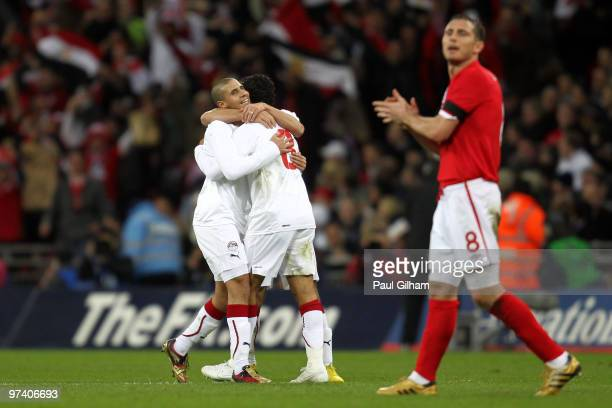 Frank Lampard of England looks on as Mohamed Zidan of Egypt celebrates with Hosny Abdrabou and Ahmed Fathy as he scores their first goal during the...