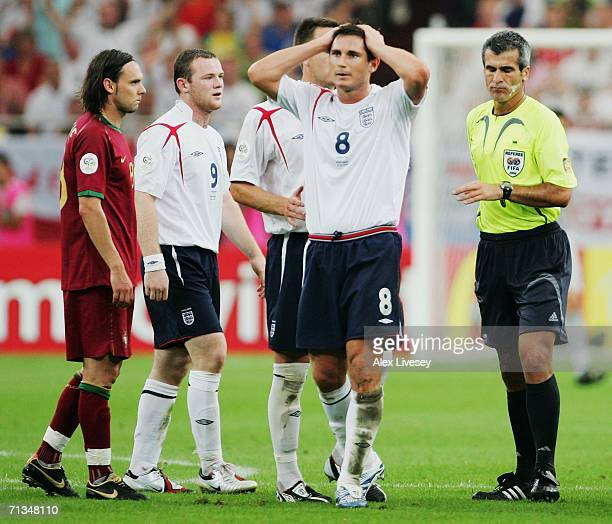 Frank Lampard of England reacts as team mate Wayne Rooney is sent off by Referee Horacio Elizondo of Argentina during the FIFA World Cup Germany 2006...