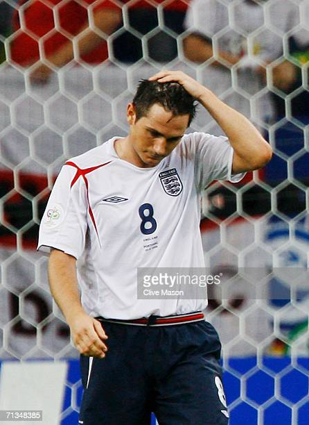 Frank Lampard of England reacts to his missed penalty in a penalty shootout during the FIFA World Cup Germany 2006 Quarterfinal match between England...