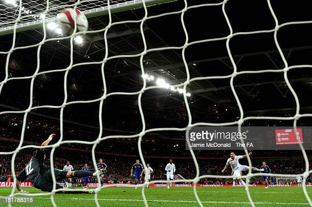 Frank Lampard of England scores from the penalty spot to level the scores at 1-1 during the FIFA 2014 World Cup qualifier group H match between...