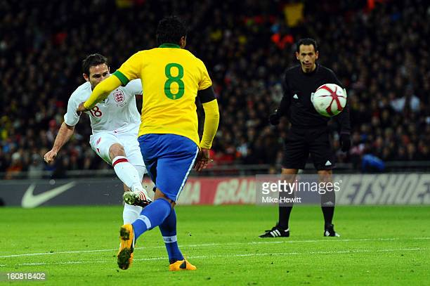 Frank Lampard of England shoots to score his team's second goal during the International friendly between England and Brazil at Wembley Stadium on...