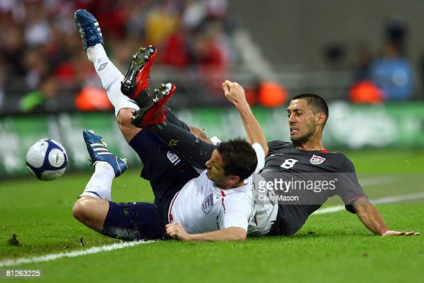Frank Lampard of England tackles Clint Dempsey of USA during the international friendly match between England and the USA at Wembley Stadium on May...