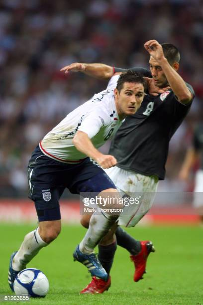 Frank Lampard of England takes on Clint Dempsey of USA during the international friendly match between England and the USA at Wembley Stadium on May...