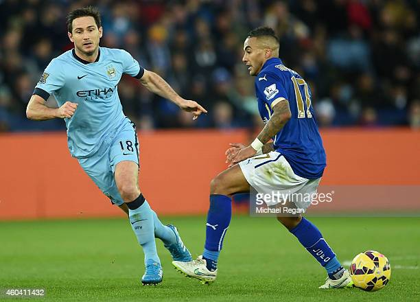 Frank Lampard of Manchester City and Danny Simpson of Leicester City compete for the ball during the Barclays Premier League match between Leicester...