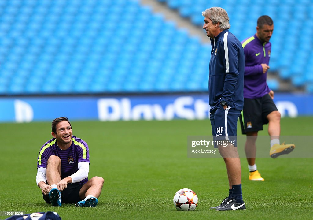 Frank Lampard of Manchester City and Manuel Pellegrini the manager of Manchester City chat during a training session at the Etihad Stadium on September 29, 2014 in Manchester, England.