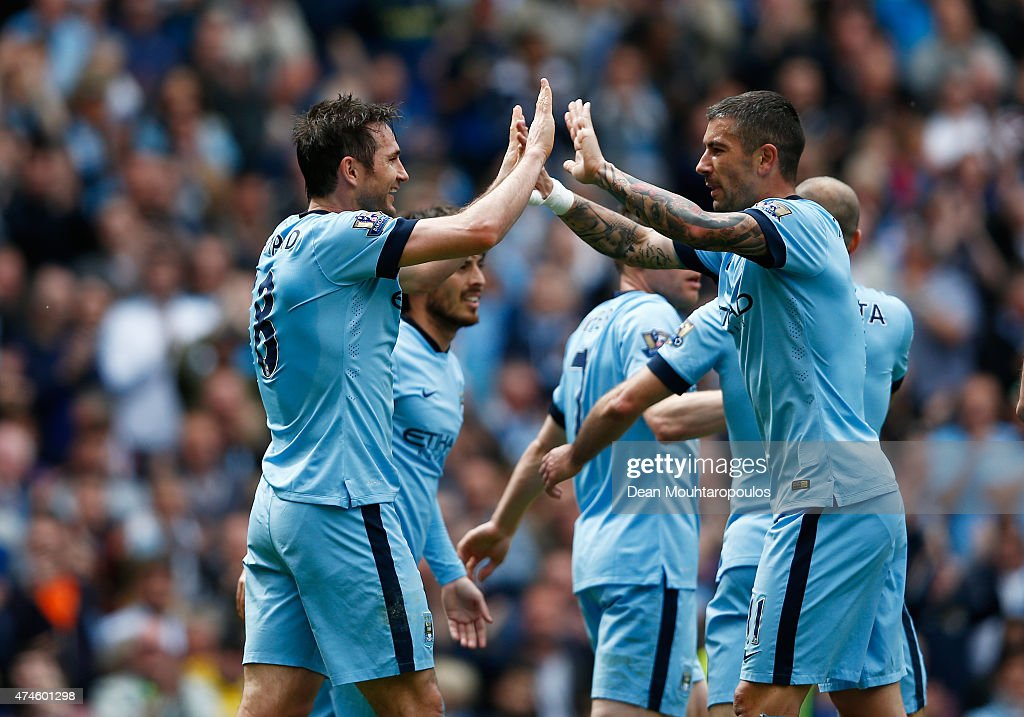 Frank Lampard of Manchester City celebrates scoring his team's first goal with his team mate Aleksandar Kolarov during the Barclays Premier League match between Manchester City and Southampton at Etihad Stadium on May 24, 2015 in Manchester, England.