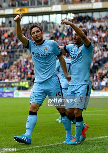 Frank Lampard of Manchester City celebrates with teammate Pablo Zabaleta after scoring his team's fourth goal during the Barclays Premier League...