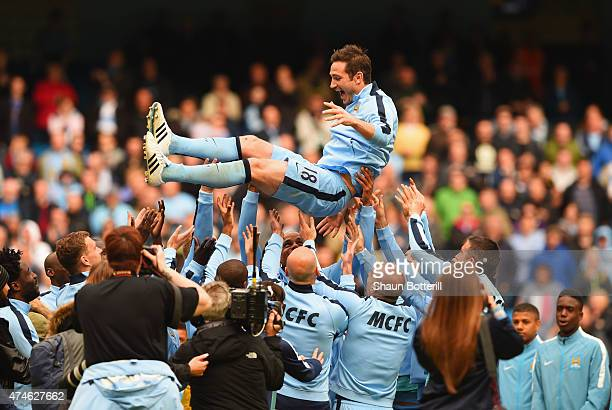Frank Lampard of Manchester City is thrown into the air by his team mates after the Barclays Premier League match between Manchester City and...