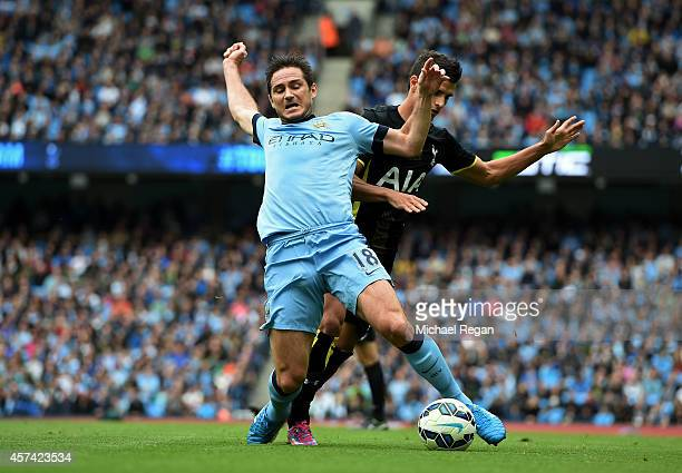 Frank Lampard of Manchester City wins his team's first peanlty as he is brought down by Erik Lamela of Spurs during the Barclays Premier League match...