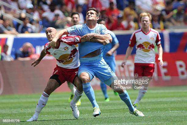 Frank Lampard of New York City FC challenges Aurelien Collin of New York Red Bulls during the New York Red Bulls Vs New York City FC MLS regular...