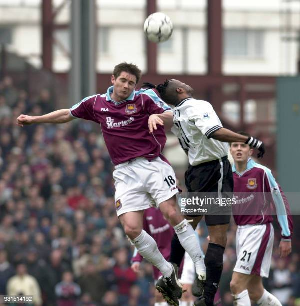 Frank Lampard of West Ham United challenges Taribo West of Derby County in the air during the FA Carling Premiership match between West Ham United...