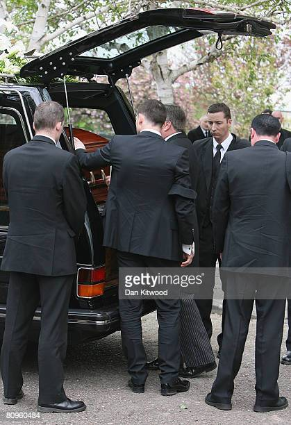 Frank Lampard places a hand on his mothers coffin at the funeral of Pat Lampard at St Margaret's church in Barking on May 2 2008 in London England