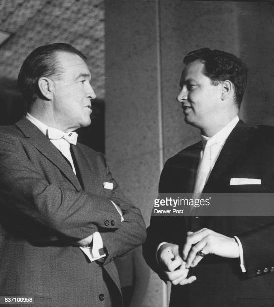 Frank Leahy former Notre Dame football coach now a resident of Los Angeles talks with Barron Hilton a son of the hotel chain president in hotel lobby...