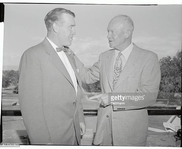 Frank Leahy former Notre Dame University head football coach enjoys a visit with President Eisenhower at the Summer White House It was reported...