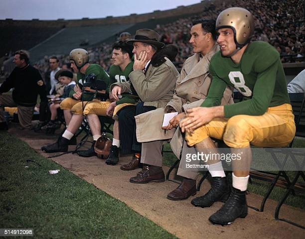Frank Leahy the Notre Dame Coach is pictured here on the bench with players