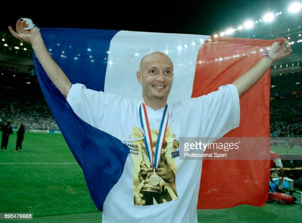 Frank Leboeuf of France celebrates with the flag after victory in the 1998 FIFA World Cup Final between Brazil and France at the Stade de France on...