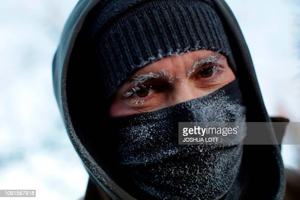 TOPSHOT Frank Lettiere's eyebrows and eye lashes are frozen after walking along Lake Michigan's ice covered shoreline as temperatures dropped to 20...
