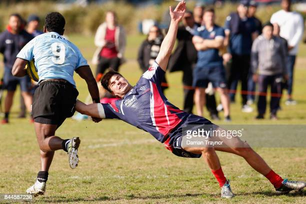 Frank Lomani of Fiji evades Jack Maddocks of Melbourne during the round two NRC match between Melbourne and Fiji at Harlequins Rugby Club on...