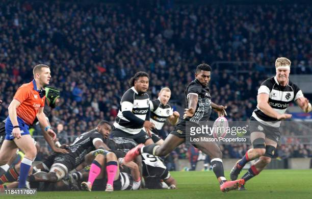 Frank Lomani of Fiji kicking upfield watched by Matt Philip of the Barbarians during the Killik Cup match between Barbarians and Fiji at Twickenham...